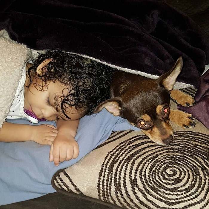 Jack Chi laying down with a baby girl