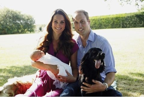 Prince William and Kate with their baby and Cocker Spaniel