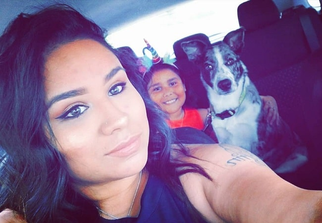 A mother taking selfie with her daughter and Catahoula Australian Shepherd